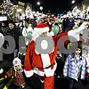 Rob Winner – rwinner@daily-chronicle.com<br /> <br /> Santa Claus marches down State Street toward the DeKalb County Courthouse in downtown Sycamore on Friday night.