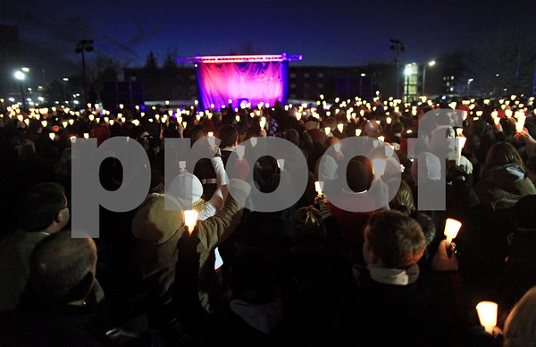 Beck Diefenbach  -  bdiefenbach@daily-chronicle.com<br /> <br /> Northern Illinois students and supporters raise ther candles at the end of the candlelight vigil at the Martin Luther King Commons on the campus of NIU in DeKalb, Ill., on Sunday Feb. 14, 2010.