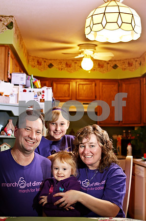 Beck Diefenbach - bdiefenbach@daily-chronicle.com<br /> <br /> Clockwise from bottom, Jaden, 2, John, J.C. , 11, and Lou Longeville at their Cortland, Ill., home.