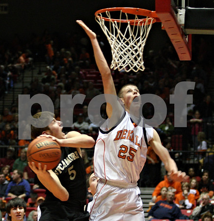 Beck Diefenbach  I  bdiefenbach@daily-chronicle.com<br /> <br /> Sycamore's Michael Buckner (5) goes up against DeKalb's Patrick Rourke (25) during the second quarter of the game at the Northern Illinois University Convocation Center in DeKalb, Ill., on Friday Jan. 30, 2009.
