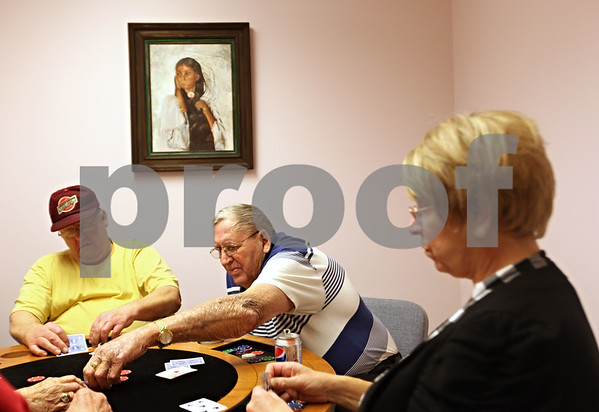 Beck Diefenbach  -  bdiefenbach@daily-chronicle.com<br /> <br /> (Left) Leonard Schramer, of Esmond, Ill., and Fred Larson (center), of Sycamore, play poker at the Senior Services Center in DeKalb, Ill., on Monday Jan. 4, 2010.