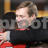 Kyle Bursaw — kbursaw@daily-chronicle.com<br /> <br /> NIU Director of Athletics Jeff Compher hugs Northern Illinois running back Chad Spann as he is announced with the rest of the senior players during the last home game of the season against Toledo in DeKalb, Ill. on Nov. 9, 2010.