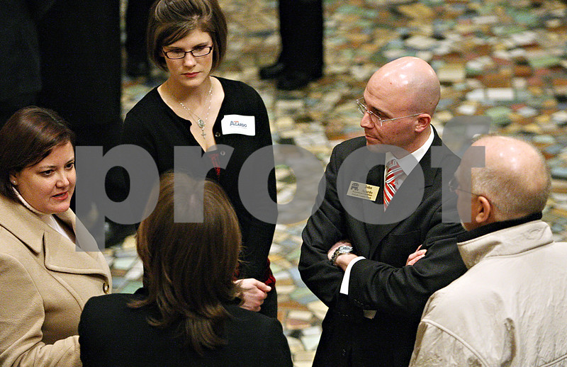 Rob Winner – rwinner@daily-chronicle.com<br /> County clerk and recorder candidate John Acardo (second from right) and his wife Megan introduce themselves at a meet and greet during the DeKalb Chamber of Commerce's Candidates' Night at the Egyptian Theatre in DeKalb, Ill. on Tuesday January 19, 2010.