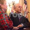 Kyle Bursaw – kbursaw@daily-chronicle.com<br /> <br /> New State's Attorney Clay Campbell, supported by wife Lisa Campbell, is sworn in at the DeKalb County Court in Sycamore, Ill. on Wednesday, Dec. 1, 2010.