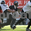 Rob Winner – rwinner@daily-chronicle.com<br /> <br /> DeMarcus Grady carries the ball during NIU football practice on Tuesday March 23, 2010 in DeKalb, Ill.