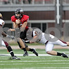 Rob Winner – rwinner@daily-chronicle.com<br /> <br /> Northern Illinois quarterback Chandler Harnish braces himself before a hit by Central Michigan defensive back John Carr during the second quarter in DeKalb, Ill. on Saturday October 23, 2010. DeKalb went on to defeat Central Michigan, 33-7.
