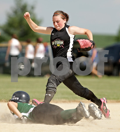 Beck Diefenbach  -  bdiefenbach@daily-chronicle.com<br /> <br /> Kishwuakee Valley Storm's Autumn Williams (4) stretches for the out at second base during the 14U game against the Bartlett Hawks in the pool play portion of the Storm Dayz softball tournament at Sycamore Park in Sycamore, Ill., on Friday June 25, 2010.