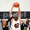 Beck Diefenbach - bdiefenbach@daily-chronicle.com<br /> <br /> Sycamore's Sam Ford (25, left) and Adam Schmitt (10, right) attempt to block a shot by DeKalb's Jordan Threloff (42, right) during the second quarter of the IHSA Class 3A regional semifinal game at Kaneland High School in Maple Park, Ill., on Tuesday March 2, 2010.