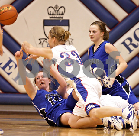 Beck Diefenbach  -  bdiefenbach@daily-chronicle.com<br /> <br /> Newark's Tara Bernard (14) gets rid of the ball after falling down during the third quarter of the game at H-BR High School in Hinckley, Ill., on Thursday Jan. 14, 2010. H-BR defeated Newark 46 to 30.