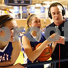 Beck Diefenbach  -  bdiefenbach@daily-chronicle.com<br /> <br /> Hinckley-Big Rock head coach Greg Burks (right) hands the microphone to  Maxzine Rossler (center) to do a radio interview as Tess Godhardt (left) stands by after defeating Stockton to win the IHSA Class 1A Super Sectional championship game at Judson  University in Elgin, Ill., on Monday Feb. 22, 2010.