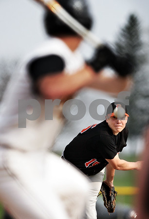 Beck Diefenbach  -  bdiefenbach@daily-chronicle.com<br /> <br /> DeKalb pitcher Ben Dallesasse (15) watches his throw during the bottom of the second inning of the game against Sycamore at Sycamore Park in Sycamore, Ill., on Tuesday April 6, 2010.