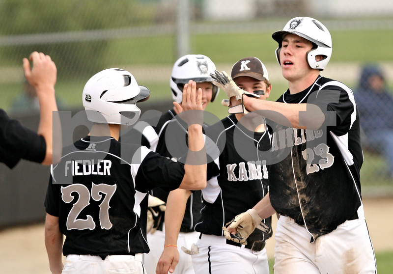 Beck Diefenbach  -  bdiefenbach@daily-chronicle.com<br /> <br /> Kaneland's Tyler Callaghan (23, right) is congratulated after  stealing home during the third inning of the game against Sycamore at Kishwuakee College in Malta, Ill., on Friday May 14, 2010.