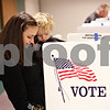 Beck Diefenbach  -  bdiefenbach@daily-chronicle.com<br /> <br /> Linus, 2, is explained voting by mother Cecilie Hueber as she fills her ballot at the Sycamore Public Library in Sycamore, Ill., on Tuesday Feb. 2, 2010.