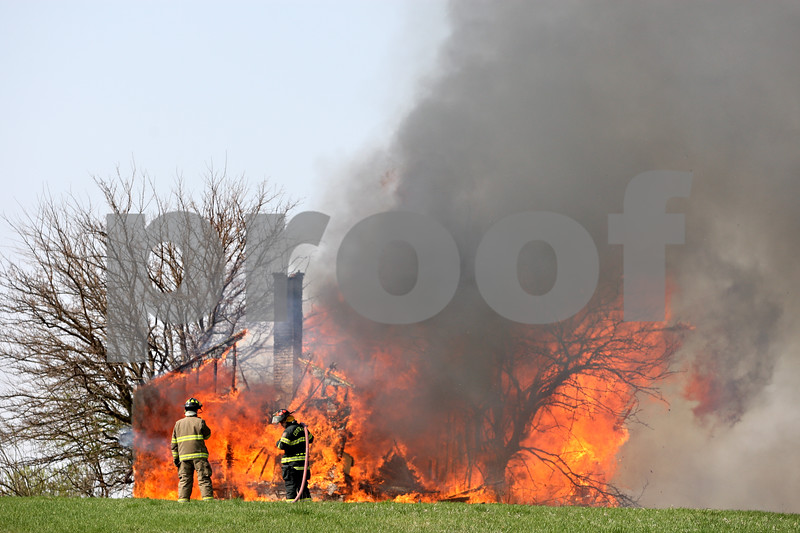 Rob Winner  -  rwinner@daily-chronicle.com<br /> <br /> Cortland firefighters watch over the controlled burn of a home off of Harter Road in DeKalb, Ill. on Saturday April 10, 2010.