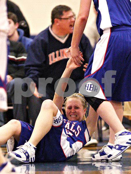 Beck Diefenbach  -  bdiefenbach@daily-chronicle.com<br /> <br /> Hinckley-Big Rock's Maxzine Rossler (bottom) is helped up after hitting the ground hard during the third quarter of the IHSA Class 1A Super Sectional championship game against Stockton at Judson University in Elgin, Ill., on Monday Feb. 22, 2010.