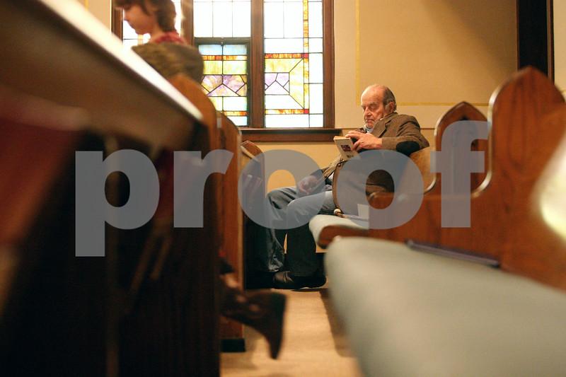 Rob Winner – rwinner@daily-chronicle.com<br /> Bruce Granath, of Somonauk, reads a book before the start of service at St. John's Lutheran Church in Somonauk, Ill. on Sunday February 21, 2010.