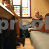 Rob Winner – rwinner@daily-chronicle.com<br /> Bruce Granath, of Somonauk, reads a book before the start of service at St. John's Lutheran Church in Somonauk, Ill. on Sunday February 21, 2010.