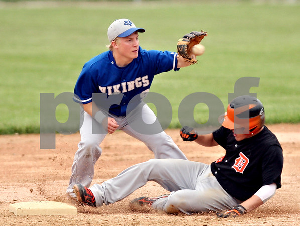 Beck Diefenbach  -  bdiefenbach@daily-chronicle.com<br /> <br /> DeKalb's Kevin Sullivan (6) slides safe into second base underneath Geneva's Brian Cornick (9) during the sixth inning of the game at Geneva High School in Geneva, Ill., on Thursday May 13, 2010. DeKalb defeated Geneva 5 to 3.