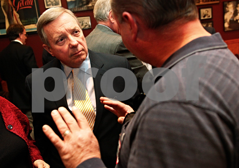Beck Diefenbach  -  bdiefenbach@daily-chronicle.com<br /> <br /> Sen. Dick Durbin listens to Matt Swanson, president of the DeKalb County Building Trades and field representative of the Laborer's International Union of North America, before a luncheon with community leaders at Johnny's Charhouse in Sycamore, Ill., on Tuesday Jan. 5, 2009.