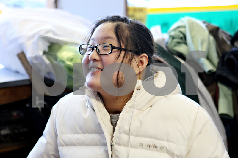 Rob Winner – rwinner@daily-chronicle.com<br /> Ashley Kim, 13, smiles while talking with two of her former classmates from Genoa Middle School when they came to visit her at her family's business in Genoa, Ill. on Thursday February 11, 2010.