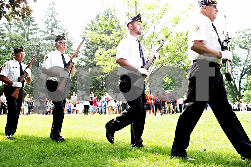 Rob Winner – rwinner@daily-chronicle.com<br /> <br /> Members of American Legion Post 66 including Jerry Kempson (from left to right), Cliff Seldal, Chris McGuire and Randy Smith leave the Ellwood House after a Memorial Day ceremony on Monday May 31, 2010 in DeKalb, Ill.