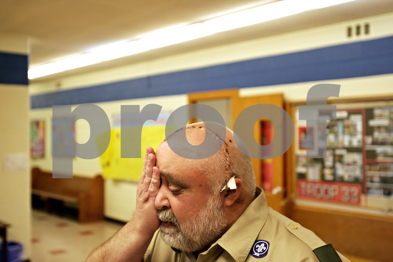 Beck Diefenbach  -  bdiefenbach@daily-chronicle.com<br /> <br /> Scoutmaster Cliff Golden covers his good eye demonstrating his temporarily impaired vision in his left eye following his Troop 33 meeting at First Lutheran Church in DeKalb, Ill., on Monday May 3, 2010. The left eye had poorly reacted to a brain surgery Cliff recently had to remove a non-cancerous brain tumor.