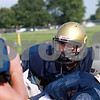 Beck Diefenbach - bdiefenbach@daily-chronicle.com<br /> <br /> Hiawatha's new quarterback Jeo Andujar relay's the play to his team during practice at Hiawatha High School in Kirkland, Ill., on Thursday Aug. 19, 2010.