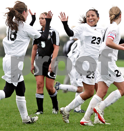 Beck Diefenbach  -  bdiefenbach@daily-chronicle.com<br /> <br /> Kaneland's Thalia Garcia (23, second from right) celebrates after scoring a goal during the first half of the game against Indian Creek at Kaneland High School in Maple Park, Ill., on Wednesday April 7, 2010. Kaneland defeated Indian Creek 7 to 0.