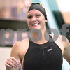 Kyle Bursaw – kbursaw@daily-chronicle.com<br /> <br /> Kristin Horney of Jacobs smiles after receiving her medal for first place in the 50 freestyle with a 24.50 seconds at St. Charles North High School on Nov. 13, 2010.
