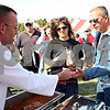 Rob Winner – rwinner@daily-chronicle.com<br /> <br /> (From left to right) Joe Inboden of Inboden's Meat Market serves Rachel Rothweil and her father, Jim Rothweil, some tailgate food before the start of Saturday's Northern Illinois homecoming game in DeKalb, Ill. on Saturday October 16, 2010.