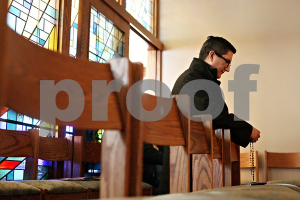 Beck Diefenbach  -  bdiefenbach@daily-chronicle.com<br /> <br /> Richard Salazar does penance following   confession at the Newman Catholic Center in DeKalb, Ill., on Saturday March 20, 2010.