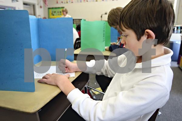 Rob Winner – rwinner@daily-chronicle.com<br /> Grant Goral, 9, fills out his answers to a spelling test at St. Mary Catholic School in DeKalb, Ill. on Tuesday January 12, 2010.