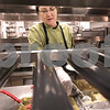 Kyle Bursaw – kbursaw@daily-chronicle.com<br /> <br /> Connie Hylland dishes up a Thanksgiving meal around lunch time for patients at Kishwaukee Community Hospital in DeKalb, Ill. on Thursday, Nov. 25, 2010.