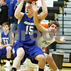 Rob Winner – rwinner@daily-chronicle.com<br /> <br /> Burlington Central's Thomas Fitzgerald controls a steal from Sycamore's Joe Costello during the second quarter of their game in Sycamore on Wednesday night.