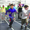 Wendy Kemp/For The Chronicle<br /> Participants take off at the starting line to begin the mini-relay marathon at the Kishwaukee YMCA on Saturday.<br /> Sycamore 4/18/10