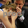 Beck Diefenbach - bdiefenbach@daily-chronicle.com<br /> <br /> Hinckley-Big Rock's Tess Godhardt (center) is consoled by assistant coach Jerry Tokars after Godhardt fouled out during overtime of the IHSA Class 1A semifinal game against Ridgewood at the Red Bird Arena on the campus of Illinois State University in Bloomington, Ill., on Friday Feb. 26, 2010.
