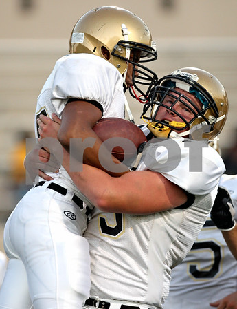 Rob Winner - rwinner@daily-chronicle.com<br /> <br /> Trent Greer (left) is lifted up by Sycamore teammate D.J. Yunek after Greer scored a touchdown in the first quarter of their game against North Lawndale at Lane Stadium in Chicago, Ill. on Saturday August 28, 2010.