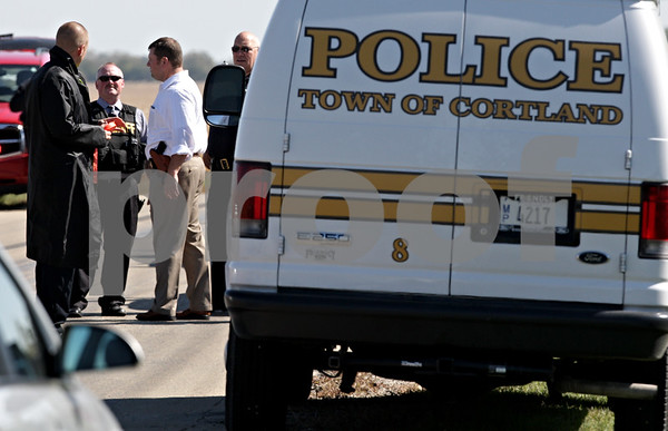 Beck Diefenbach – bdiefenbach@daily-chronicle.com<br /> <br /> Cortland police and sheriff's deputies stand by on Cortland Center Road after catching a suspect involved in a home invasion at 67 E Daisy Avenue in Cortland, Ill., on Tuesday Sept. 28, 2010.
