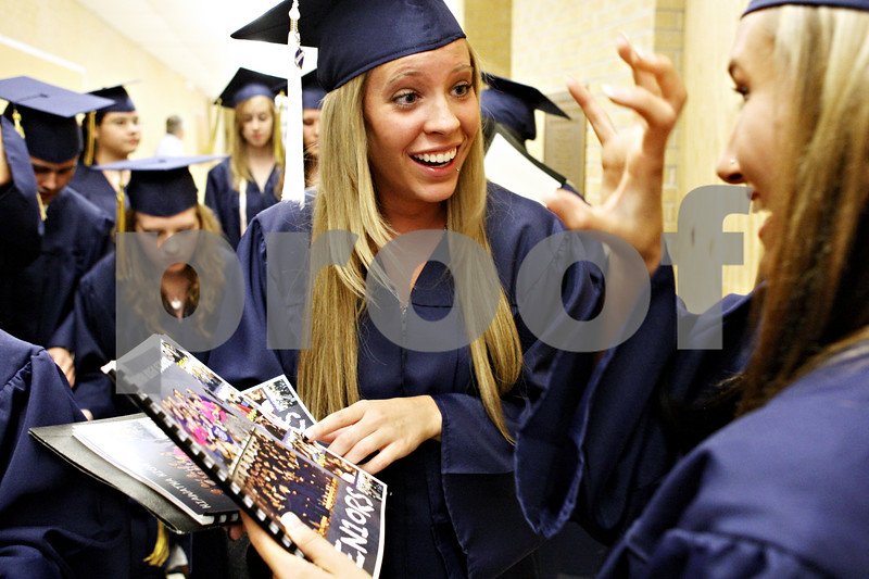 Rob Winner  -  rwinner@daily-chronicle.com<br /> <br /> Hiawatha graduating seniors Joline Conro (left) and Breyonna Baisden look through their senior book while lining up for their graduation ceremony on Friday May 28, 2010 in Kirkland, Ill.