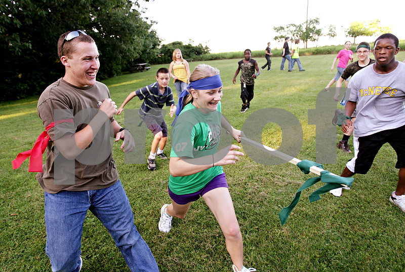 Beck Diefenbach  -  bdiefenbach@daily-chronicle.com<br /> <br /> Elyse Roberts, of DeKalb, runs away with the flag during a capture the flag tournament at Chief Shabbona Forest Preserve for youth members of the Village Bible Church on Wednesday June 30, 2010.