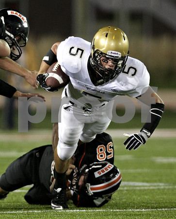 Beck Diefenbach – bdiefenbach@daily-chronicle.com<br /> <br /> Sycamore running back Eric Ray (5) is taken down by DeKalb Andrew Sarver (58) during the second quarter of the Castle Challenge football game between DeKalb and Sycamore High Schools at Huskie Stadium on the campus of Northern Illinois University in DeKalb, Ill., on Friday Sept. 10 2010.