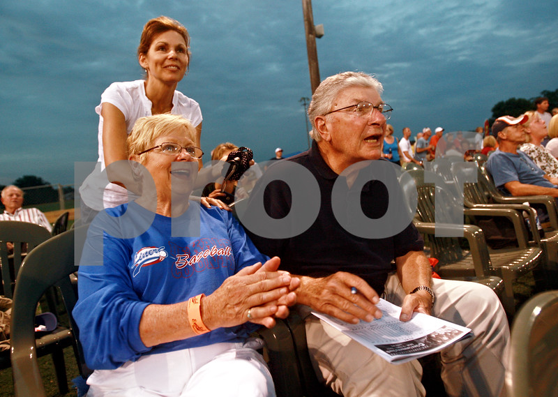 Beck Diefenbach  -  bdiefenbach@daily-chronicle.com<br /> <br /> Host family members Pat (left) and Ron Kripner, of Sycamore, cheer on the DeKalb County Liners during the game against the Springfield Sliders at Sycamore Park in Sycamore, Ill., on Wednesday Aug. 4, 2010. The Kripners hosted both pitcher Kurt Spomer and catcher Joey Bowens.