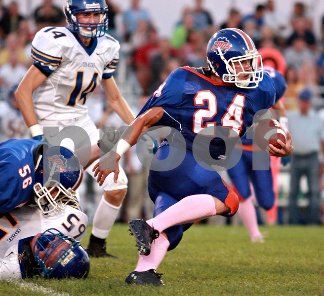 Beck Diefenbach  -  bdiefenbach@daily-chronicle.com<br /> <br /> Genoa-Kington running back Robert Thurlby (24) rushes with the ball during the first quarter of the game agianst Aurora Central Catholic at Genoa-Kingston High school in Genoa, Ill., on Friday Aug. 27, 2010.
