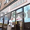 Rob Winner – rwinner@daily-chronicle.com<br /> <br /> Library clerk Jim Kline locks up the front door of the Genoa Public Library as the library closes for the day on Saturday August 14, 2010 in Genoa, Ill.