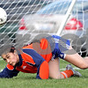 Beck Diefenbach  -  bdiefenbach@daily-chronicle.com<br /> <br /> Genoa-Kingston goalie Nicole Crozier watches as a ball she blocked bounces away during the first half of the game at G-K in Genoa, Ill., on Monday april 26, 2010. H-BR defeated G-K 5 to 1.