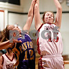 Beck Diefenbach  -  bdiefenbach@daily-chronicle.com<br /> <br /> Indian Creek's Kate Thuestad (15) grabs the rebound above Paw Paw's Casey Crawford (12) during the first quarter of the IHSA Class 1A Regional game at Indian Creek High School in Shabbona, Ill., on Monday  Feb. 8, 2010.