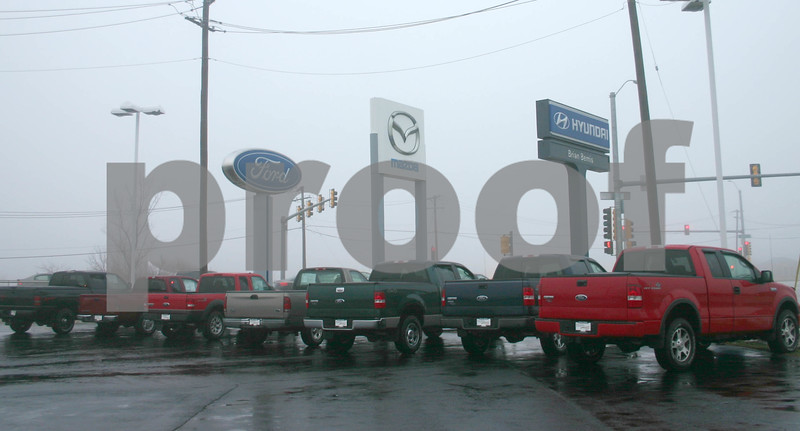 Despite foggy, rainy weather on New Years Eve, auto dealerships such as Brian Bemis in Sycamore were busy with customers who took advantage of year-end sales offerings.<br /> <br /> By NICOLE WESKERNA nweskerna@daily-chronicle.com