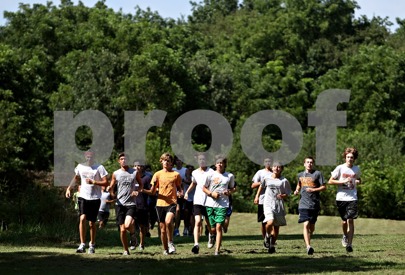 Rob Winner – rwinner@daily-chronicle.com<br /> <br /> The Kaneland cross country team practices in Elburn, Ill. on Wednesday August 18, 2010.