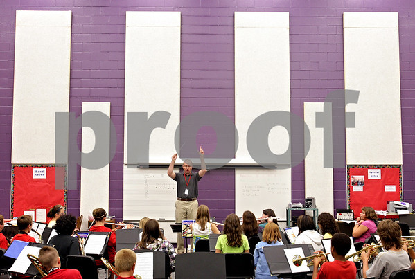 Beck Diefenbach  -  bdiefenbach@daily-chronicle.com<br /> <br /> Band director Scott Mertens leads class in the new band/orchestra room at Sycamore Middle School in Sycamore, Ill., on wednesday Sept. 1, 2010.