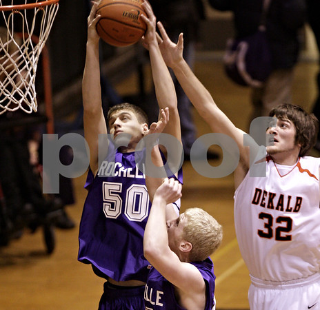 Beck Diefenbach  -  bdiefenbach@daily-chronicle.com<br /> <br /> Dekalb's Jake Jouris (32, right) tries to stop a shot by Rochelle's Joe Torres (50) during the first quarter of the game at DeKalb High School  in DeKalb, Ill., on Friday Jan. 8, 2010.